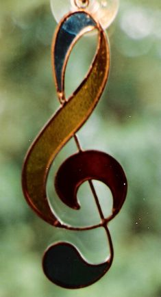 Really like the fluidity of this treble clef ornament -- for the music lover