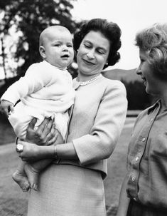 1960: Prince Andrew at 6 months old at Balmoral, held by mother Queen Elizabeth II while a young Princess Anne looks on. (AP Photo)