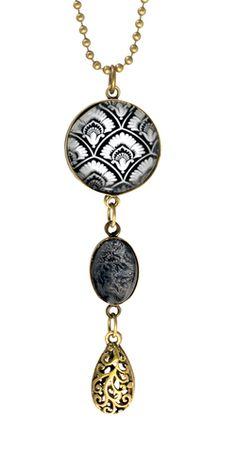 Product Features: - Beautiful 70cm ball chain necklace - Classic black & white fan print - 3 pendants - Brass finish. www.fabuleuxvous.com