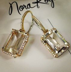 18k diamond and white topaz stunners. These would make some pretty incredible wedding day earrings !