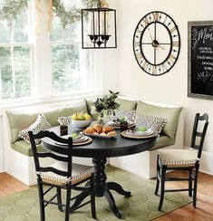 A built in banquette is a great way to squeeze extra seating into the corner of a kitchen. Cushions in outdoor fabric mean this spot will stand up to kids, pets, and any other messes that may come its way.