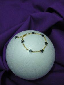 Pulsera de estrellitas de hematite y cadena de oro amarillo