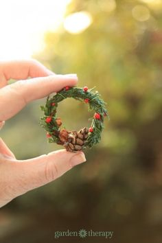 Finished miniature wreath with real evergreens, pinecones, and seed heads