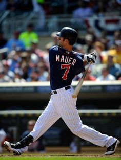 Joe Mauer #7 of the Minnesota Twins hits a three run home run against the Los Angeles Angels of Anaheim during the fifth inning on April 12, 2012