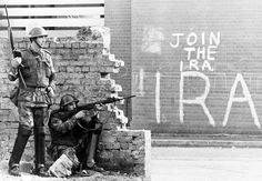 Armed soldiers behind a wall on Derry, N.Ireland.  People always forget why we fought them and what they did to us.......I'm so glad it's over.