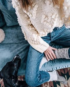 Cuddling up with a statement sweater and some knit socks via @jessannkirby