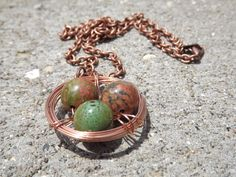 $23 - www.etsy.com/shop/JustHeathersJewelry - Copper bird's nest necklace - wire wrapped - semi-precious unakite & green beads - birdnest - robin's nest - stone - gift idea. Use coupon code PINS15 for 15% off your total purchase.