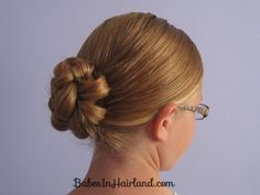 Rolled Up Four Strand Braid Bun from Babes in Hairland