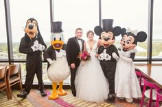 Mickey, Minnie, Goofy, and Donald make an appearance at a Disney Fairy Tale Wedding reception at California Grill
