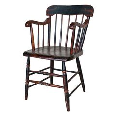 Lovely 19th century low stick back painted Windsor chair found in Pennsylvania. The chair has rolled arms and two beautiful turned front stretchers.