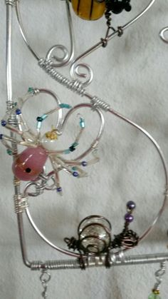 Wire wrapped beaded sun catcher with spider and snail.