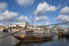 Perched on the banks of the River Douro, Porto is a charming city with a rich history. Take a walk along the river, where you'll be sure to spot flat-bottomed barcos rabelos, which are no longer used for transporting the wine but remain a symbol of Portugal's rich maritime tradition.
