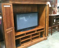 "Hekman 7-8051 Mountain Retreat Plasma  $750.00 each {We just got 3 in}   Bi-fold doors wrap around to sides of cabinet  Fixed television shelf located 21 3/4"" from floor  Fixed and adjustable shelves below television for storage of electronics  Accommodates most 50"" flat panel televisions  Finished in a hand-rubbed Indian Summer finish.  Flipworks all-media storage system accomodates audio, video, gaming and computer media formats  Dims;  W. 67""  D. 26""   H. 67"""