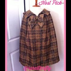 """Host PickVintage Plaid Wool Cape With Bow An incredible find that unfortunately is too big for me. Vintage wood tweed plaid cape with large bow at collar. The plaid has brown, tan, gold colors with hints of pink throughout. Two snaps at collar and two arm slits. Gentle large pleats all around starting at shoulders. Lined in vibrant gold satin. Believe this to be custom made- tag reads 'Custom Original Tailoring for Alice E Smith'. Thanks Alice! Measures 20"""" across shoulders, 34"""" waist(not…"""