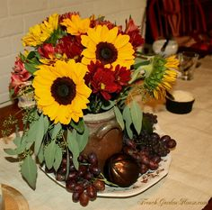 This makes me think of cool days, crunchy leaves, and a hot bowl of soup with crusty bread. How wonderful when a centerpiece can evoke such thoughts!!