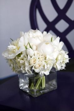 Plain glass vase rises to elegance with white flower bouquet of different shapes and sizes  <3