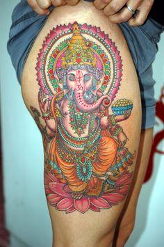 Wow! Colourful thigh tattoo.
