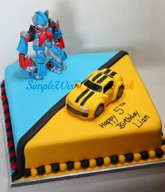 """12"""" Optimus Prime and Bumblebee cake. Both figures are hand made from fondant. Transformer Party, Bumble Bee Transformer Cake, Transformers Birthday Parties, 4th Birthday Parties, Birthday Fun, Birthday Cake Kids Boys, Birthday Ideas, Rescue Bots Cake, Rescue Bots Birthday"""