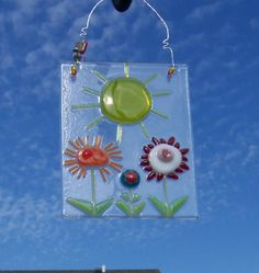 Fused Glass Suncatcher featuring a Fun Folksy Flowers a Sun and Hammered Wire Hanger