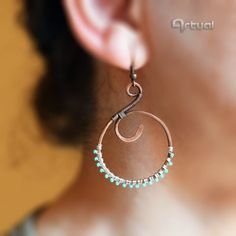 Wire wrapped hoop earrings with turquoise seed beads via Artual jewelry. Click on the image to see more!