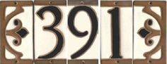 House Number Tiles. $19 each. The house numbers are made of stoneware clay which is suitable for outdoor use. They include pre-drilled holes and brass screws for mounting. There is also a decorative end design that can be used on either side to create a frame. These tiles will enhance the appearance of any Arts & Crafts, Mission, or Bungalow style home.