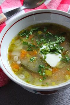 Pearl Barley Soup (Kruubisupp in Estonia) – cooked pearl barley with handful of veggies cut is small cubes (carrots, celery root, leek, potatoes), garnished with sour cream and chopped parsley.