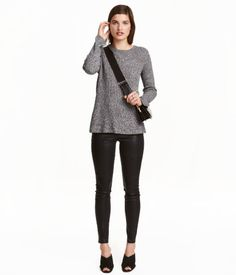 Black/coating. Treggings in superstretch twill with mock front pockets, regular back pockets, and an elasticized waistband.