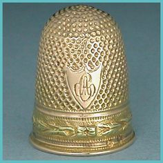 Antique Two Color 18 Ct Gold French Thimble * C1809-1819  $375.00    This elegant rounded top rose gold thimble has the French cock's head hallmark used for 18 Caret gold