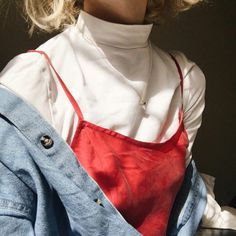 White turtleneck with red slip dress and denim jacket