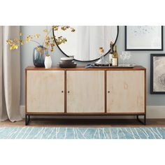 A perfect combination between rustic and contemporary, this buffet features a reclaimed wood finish doors a metal base and a solid pine wood case. It's certainly to enhance any dining decoration.