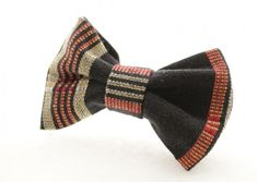 Red and Black Striped Clip on Bow Tie - Scrapcycling – This one of a kind upcycled clip on bow tie was made from a heavy red and black striped cotton upholstery sample and a versatile, easy to attach clip at the back. It would add a unique touch to a wide variety of outfits and make a great gift!