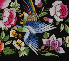 Chinese export embroidered shawl, black silk lavishly decorated with peacocks, birds and large flowers in brilliant hues, having long knotted silk fringe, 1920's, detail 3