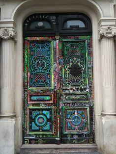 Old painted wooden door in Paris
