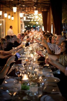 Long table wedding reception, 100 people strong!   A Wine Lover's Wedding and Banquet at Sunset and Vines, Lake Las Vegas   Photo: Gin & Sake Productions