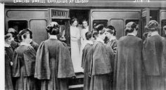 Nurses Boarding a train at a London station, during World War I. c1915.