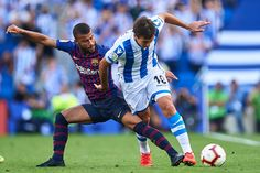 Rafinha Alcantara of FC Barcelona (L) competes for the ball with Mikel Oyarzabal of Real Sociedad (R) during the La Liga match between Real Sociedad and FC Barcelona at Estadio Anoeta on September 2018 in San Sebastian, Spain. Fc Barcelona, Camp Nou, Uefa Champions League, Photo L, Spain, September, Football Players, Philippe Coutinho, The League