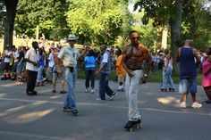 Roller skaters dancing in Central Park. NYC.