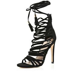 Black strappy tassel heeled sandals ($100) ❤ liked on Polyvore featuring shoes, sandals, heeled sandals, high heels stilettos, lace up sandals, open toe sandals and strap heel sandals