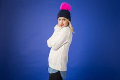 Pink faux fur pom pom and navy beanie hat with sweater, denim shirt and jeans outfit cocomamastyle.com