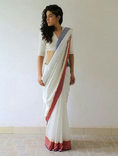 Simple woven white saree with contrasting border