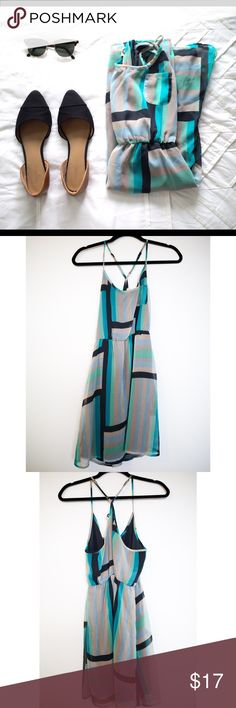 Roxy Sundress Geometric patterned, flowy sundress. In good condition other than a minor snag on the chest area. Roxy Dresses Midi