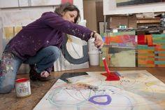 Jane Davies painting in her studio