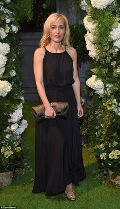 Flawless:The 47-year-old actress oozed sophistication and elegance in a simple floor-length black halter neck dress