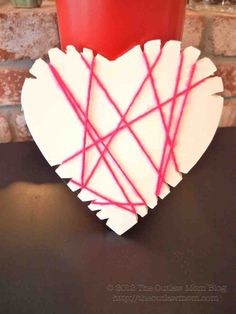 Lacing Hearts Activity - Tutorial.  Very cute - check out all the pics. The one shown here was done by a toddler; the one by the mom is really pretty!