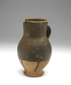 pitcher 1375 - 1450 Dimensions h. 18.9 x w. 12.5 x d. 11.5 x diam. 8.1 cm Material and technique iron engobe, proto-stoneware