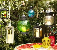 Hanging lanterns look magical. I will try to recreate something like this for sure. #Pier1Outdoors #Ad