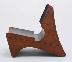 "Chair-Pedestal-Picture Rack      			 Frederick Kiesler (American, born Romania. 1890–1965)      			   	              	              	         	c. 1942. Wood and linoleum, 31 1/2 x 18 x 37"" (80 x 45.7 x 94 cm). Gift of Mrs. Ruth Abrams"