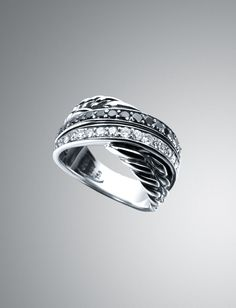 """David Yurman- cross over-web-May.2013,USD 1200, •From the Graphite Collection®.  •Sterling silver crisscross ring with Cable detail; .63 total metal karat weight.  •White and black diamonds.  •1/2"""" wide.  •Imported."""