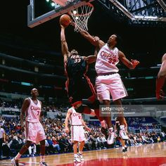 Alonzo Mourning #33 of the Miami Heat shoots against Brian Skinner #32 of the Los Angeles Clippers circa 2000 at Staples Center in Los Angeles, CA.
