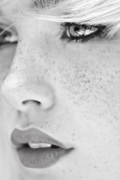 We would like to write a poem about the singular beauty of a freckle.
